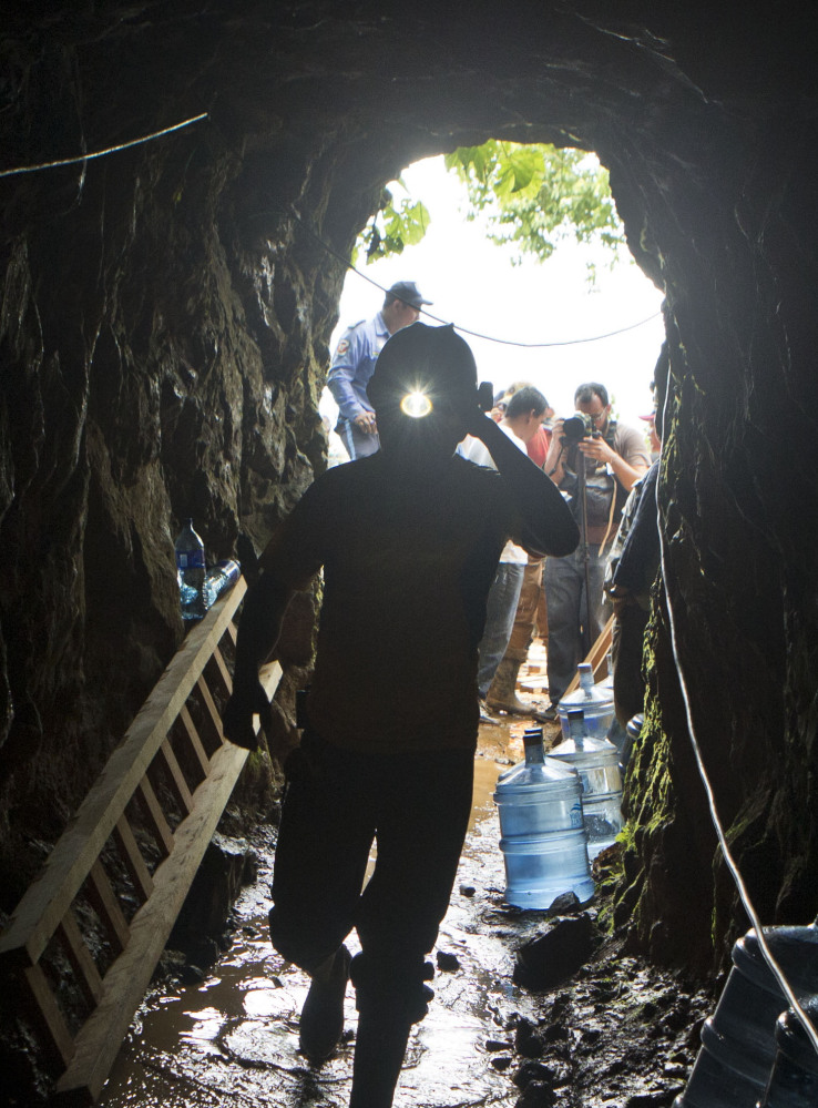 A miner enters the El Comal gold and silver mine to help with rescue operations Friday.