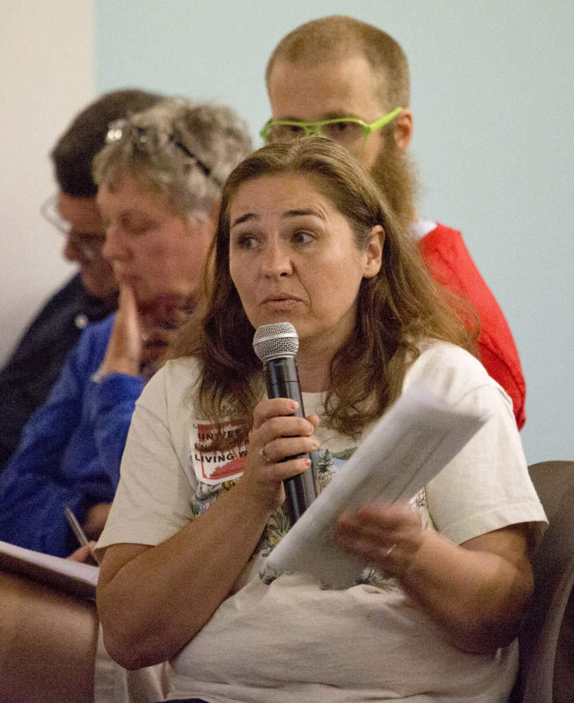 Karen Cairnduff of Portland said she supports raising the minimum wage during a public forum held at the Portland Public Library on Wednesday.