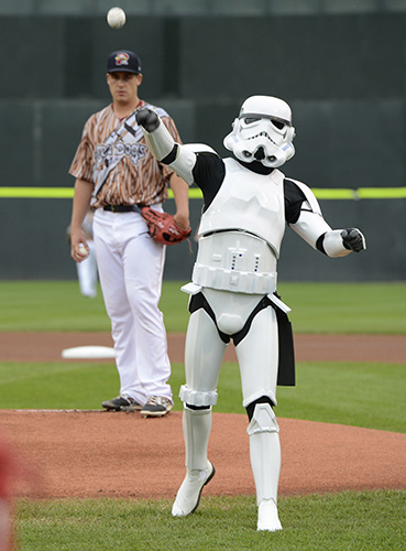 A storm trooper throws the first pitch as Portland's starting pitcher Keith Couch watches as the Portland Sea Dogs host the Richmond Flying Squirrels and celebrate Star Wars Night at Hadlock Field in Portland. John Patriquin/Staff Photographer