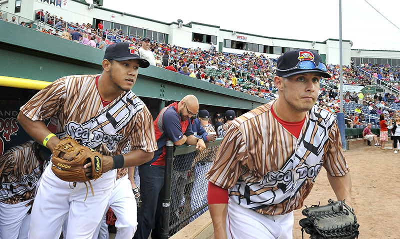 Portland's Heiker Meneses and Shannon Wilkerson head to the field in new uniforms for the start of the Portland Sea Dogs game against the Richmond Flying Squirrels on Star Wars Night at Hadlock Field in Portland. John Patriquin/Staff Photographer