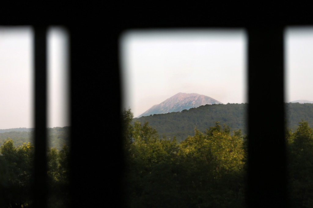 A view of Mount Katahdin through a window at Lunksoos Camps in an August 2014 photo. The camps serve as the base for Elliotsville Plantation Inc., the organization that worked to create a national monument in the North Woods.