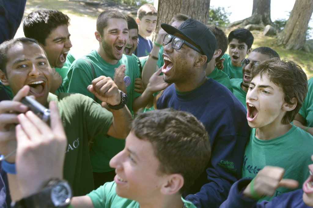 Marcus Smart is surrounded by campers while posing for cellphone photos Friday after the introduction of players at the the Seeds of Peace camp in Otisfield.