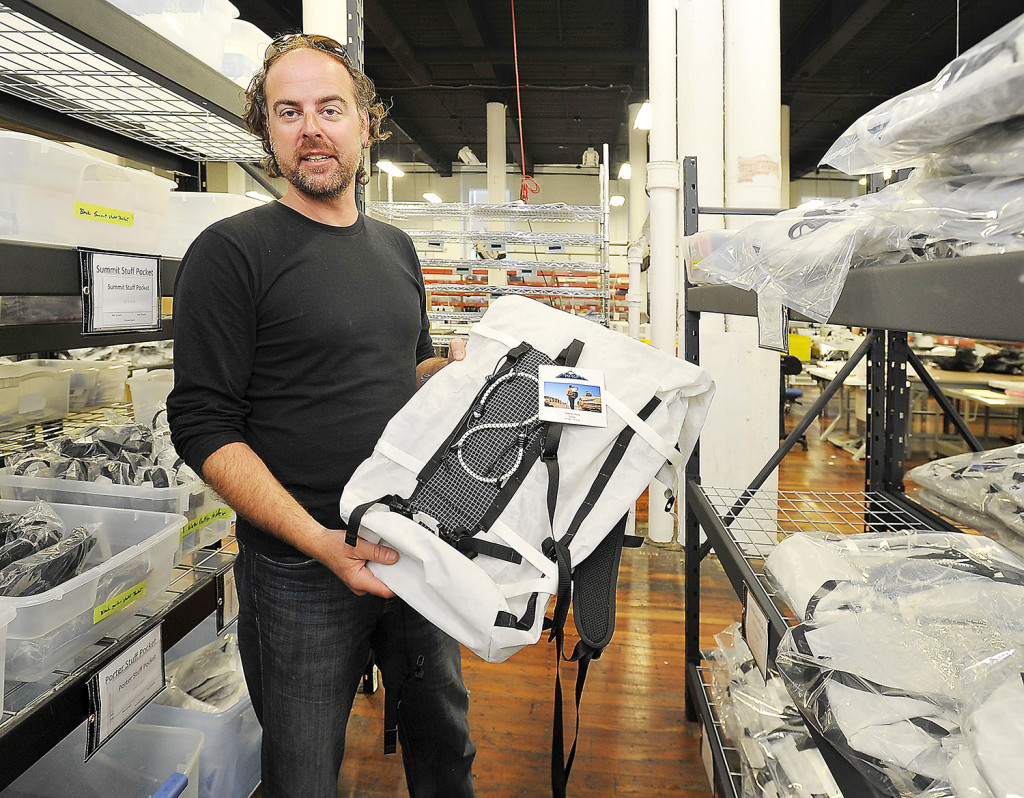 Dan St. Pierre, CFO and co-founder of HyperLite Mountain Gear, shows one of his company's ultralight products, the Icepack. The company relocated from a much smaller space in another building to the new, larger space in Pepperell Center.