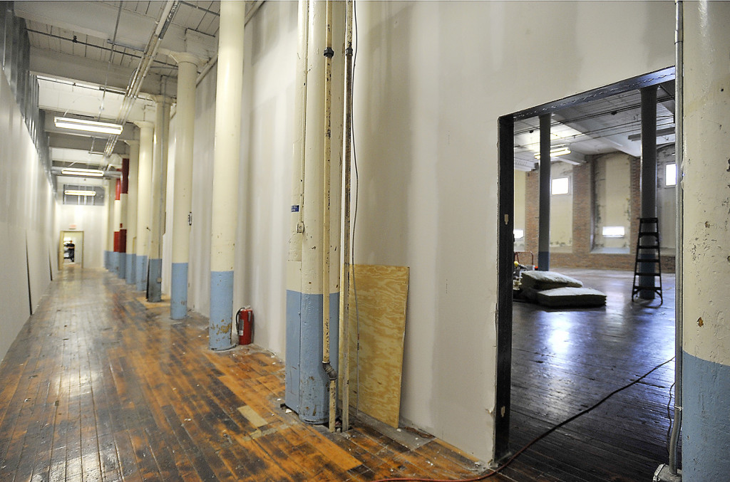 Large rooms and hallways are being created out of the open space of the old mill during the development of Pepperell Center.