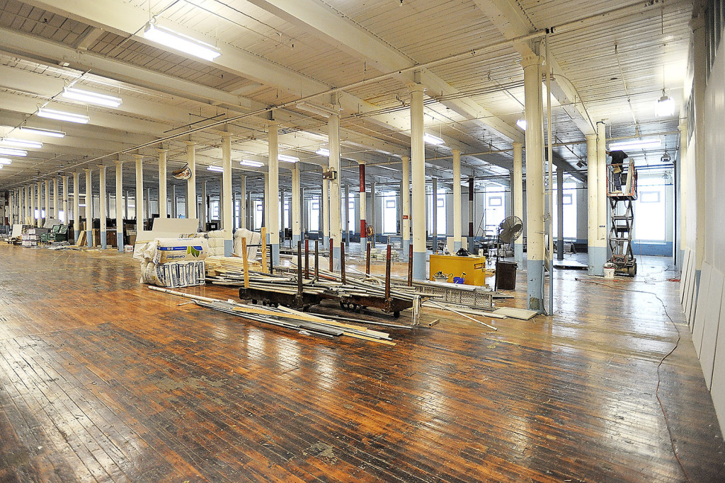 This open floor of an old mill building is being divided by construction workers to create open common areas and closed rooms during the development of Pepperell Center.