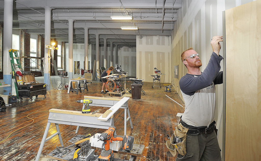 "Contractor Nick Blais does trim work at the  Pepperell Center. Think Tank Biddeford's new co-working space will occupy 3,000 square feet of the center and include 11 private offices, eight dedicated desks and several work stations that are available to people who are called ""floating"" members."