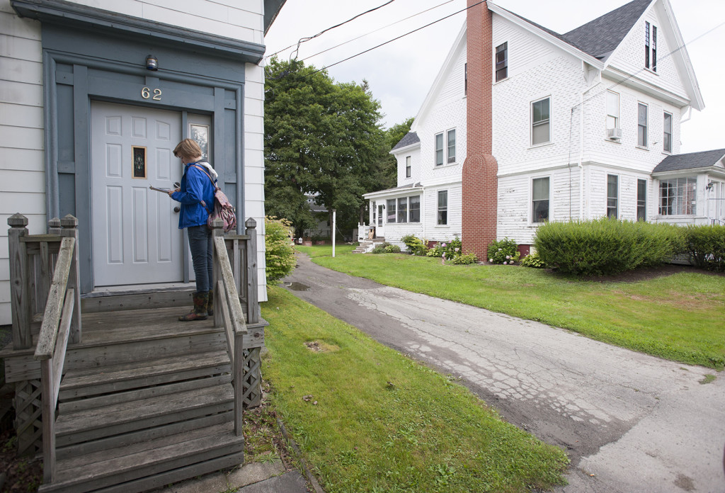 Waiting at a door, democratic canvasser Emma Howard has already been briefed on what to say to residents of Maple Street in Bangor who organizers identified as voters on the fence.