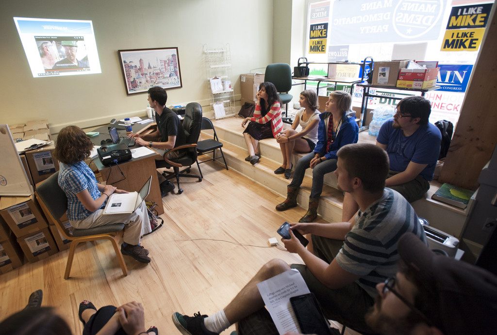 Democratic canvasser watch the latest Mike Michaud video as they are briefed by organizers at Democratic headquarters before knocking on voters doors.