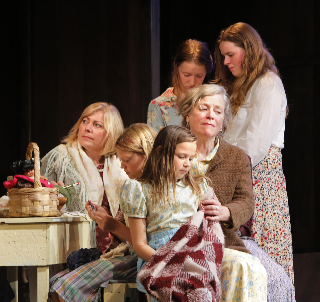 "Women and their daughters look forlorn in this scene set in a kitchen in a Deer Isle house in the play ""The Last Ferryman"" which depicts the winter of 1934 when Eggemoggin Reach froze solid and ferry service to the island was halted. This caused some islanders to go without heat because fuel oil trucks could no longer get to the island. The harsh winter and halt in ferry service helped the effort to build a bridge to Deer Isle gain momentum."