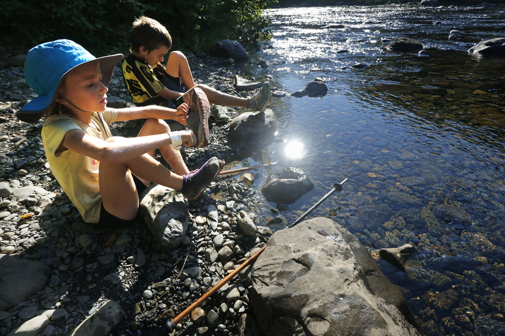 Madeline and Nathan Kallin put on their shoes after crossing a stream while hiking near Gulf Hagas.