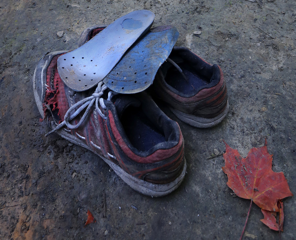 A battered pair of shoes belonging Nathan Kallin, 9, were retired where he was camping with his family near the Appalachian Trail. The family members were all on their third pair of sneakers, except for Nathan, who was on his fourth pair.