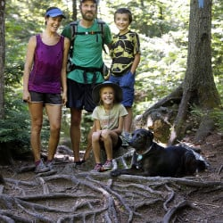 The Kallin family, Dave and Emily, their children Nathan, 9, and Madeline, 8, and their dog Orion, pause for a family portrait near Gulf Hagas, a registered national landmark along the Appalachian Trail corridor.  The Dresden family started out on the AT in Georgia in April and hopes to finish atop Mount Katahdin next week.