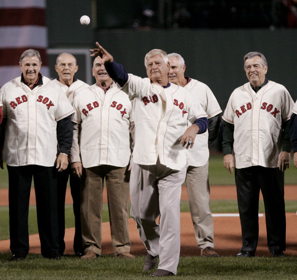 Backed by members of the 1967 Red Sox team, Baseball Hall of Famer Carl Yastrzemski throws out the ceremonial first pitch at Game 1 of the 2007 World Series between the Colorado Rockies and Boston on Oct. 24, 2007 at Fenway Park.   The Associated Press
