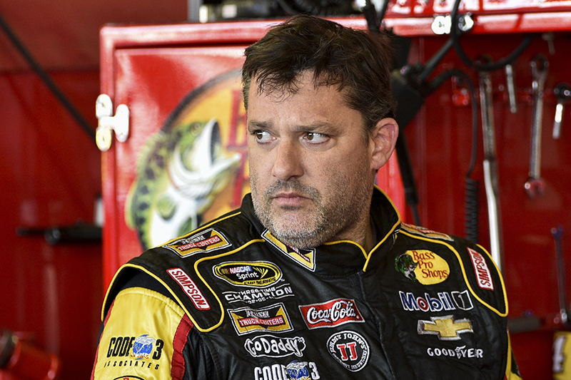 Tony Stewart stands in the garage area after a practice session for Sunday's NASCAR Sprint Cup Series auto race at Watkins Glen International, in Watkins Glen N.Y. The Associated Press