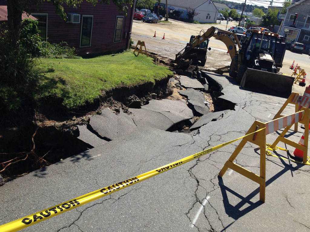 A giant hole appeared after heavy rains Wednesday night at Rufus Deering Lumber on Commercial Street in Portland.