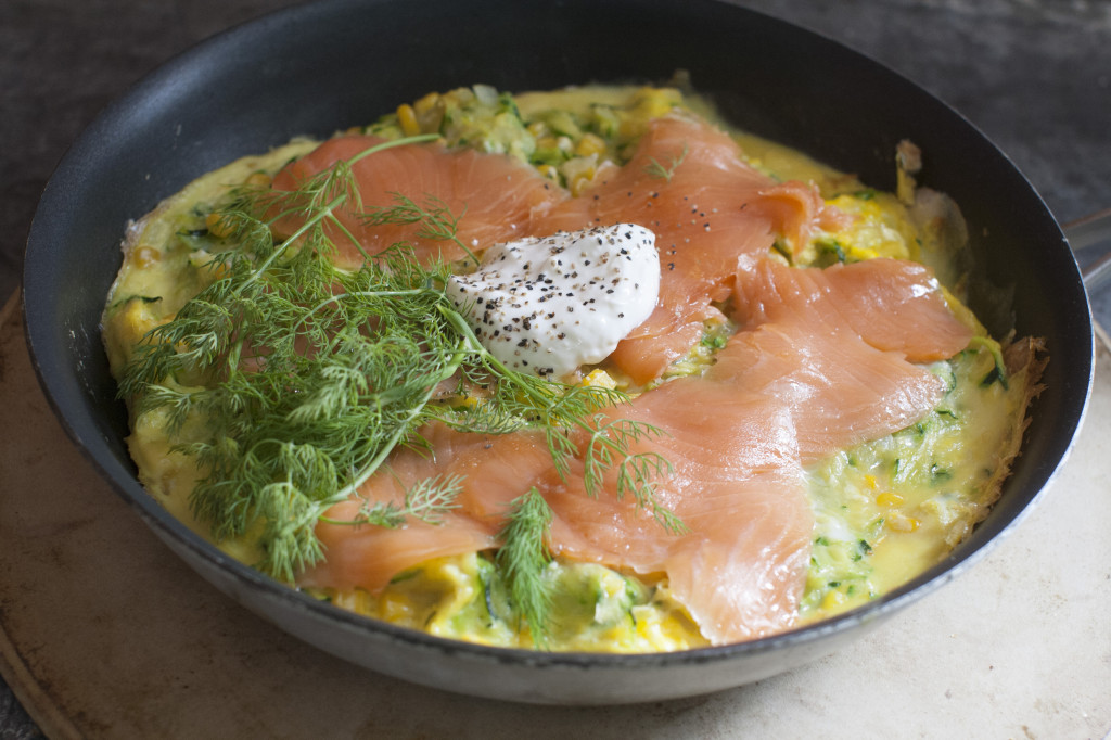 Open-faced corn and zucchini omelet with smoked salmon