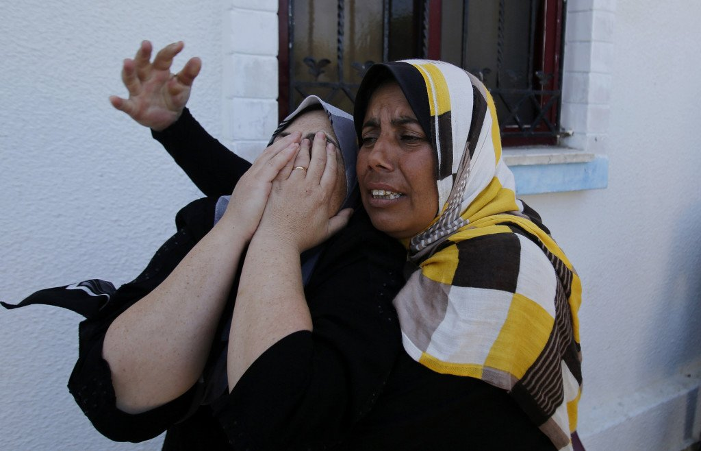 Palestinian relatives of Islamic Jihad militant Shaaban Al-Dahdouh, whose body was found under the rubble Tuesday, grieve during his funeral in Gaza City, Wednesday. The Associcated Press