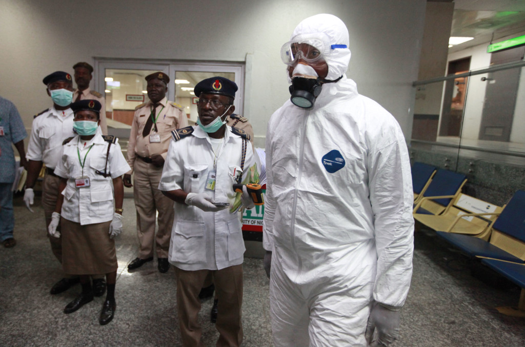 Nigerian health officials wait to screen passengers at the arrival hall of Murtala Muhammed International Airport in Lagos, Nigeria, Monday. Nigerian authorities on Monday confirmed a second case of Ebola in Africa's most populous country. The Associated Press