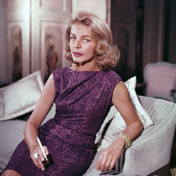 Lauren Bacall poses at her home in New York in 1965. Bacall, the sultry-voiced actress who was Humphrey Bogart's partner off and on the screen, died Tuesday in New York. She was 89.