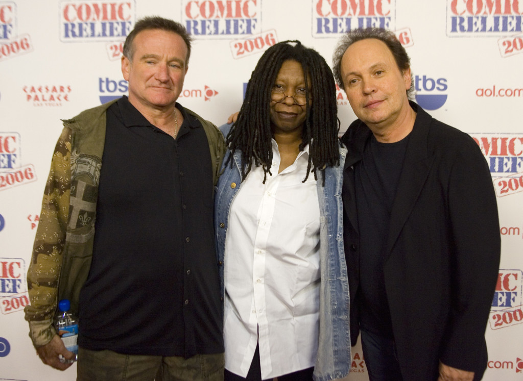 """Comedians Robin Williams, left, Whoopi Goldberg and Billy Crystal posing after hosting """"Comic Relief"""" at Caesars Palace Hotel and Casino in Las Vegas in November 2006."""