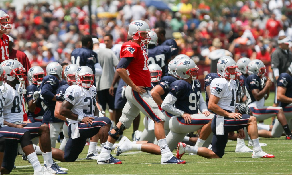 New England Patriots QB Tom Brady, center, works out before a training camp scrimmage between  New England and Washington in Richmond, Va., Tuesday. The Associated Press