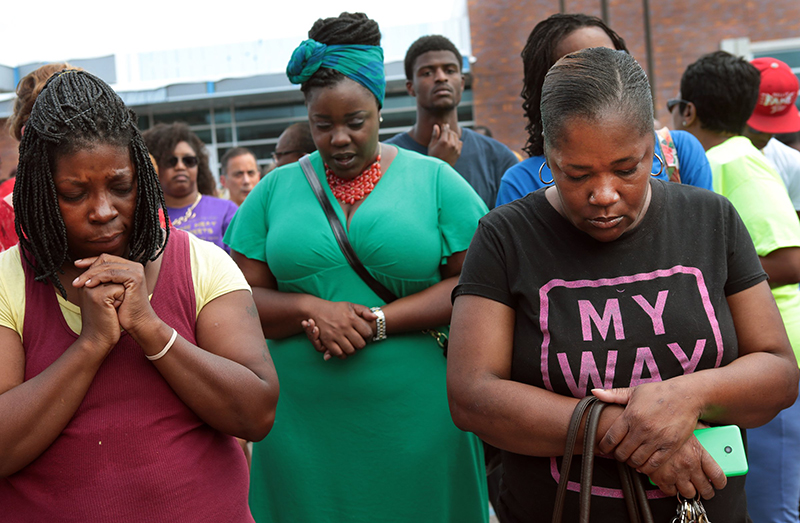 A prayer vigil was held in front of the Ferguson, Mo. police department on Sunday. The Associated Press.