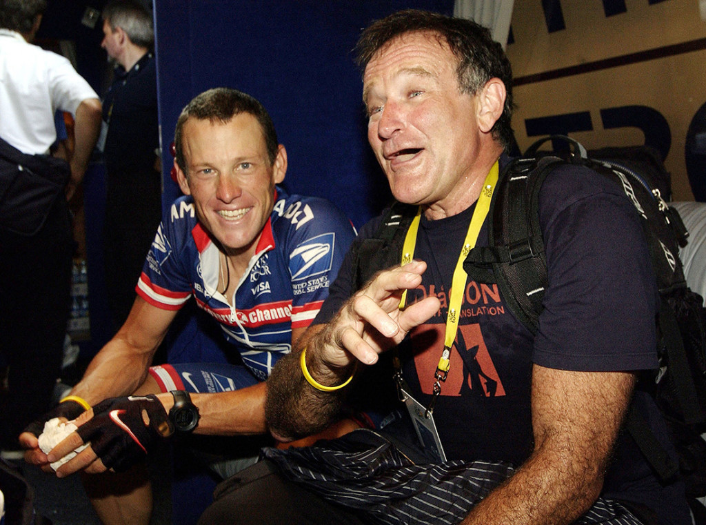 Robin Williams jokes with U.S. Postal rider Lance Armstrong before the start of the 15th stage of the Tour de France between Valreas to Villard-de-Lans, France, July 20, 2004.