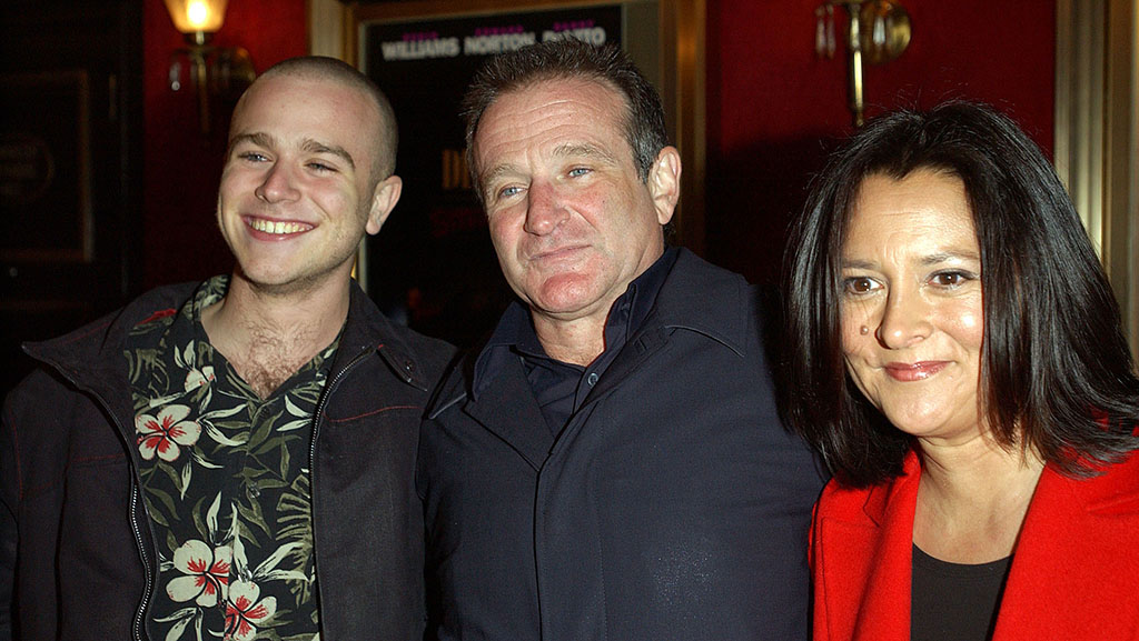 """Williams with wife, Marsha, and son Zach enters the premiere of the 2002 movie """"Death to Smoochy."""""""