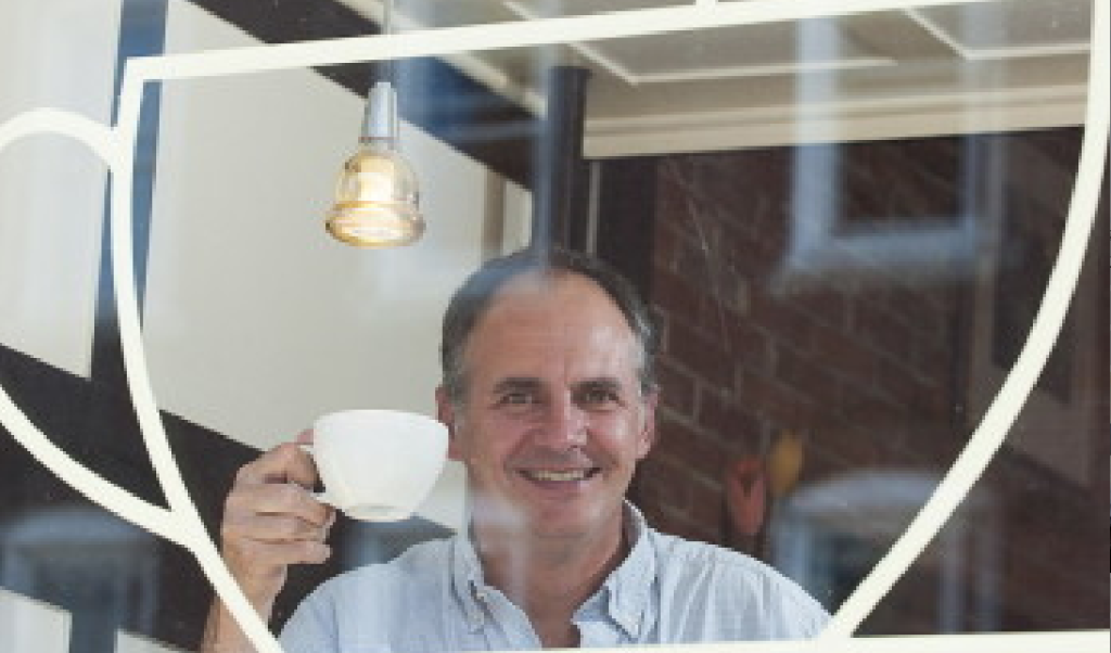 "Murray Campbell, author of ""Caffeinated,"" has the usual, ""just coffee,"" at Bay Wrap coffee shop in Belfast."