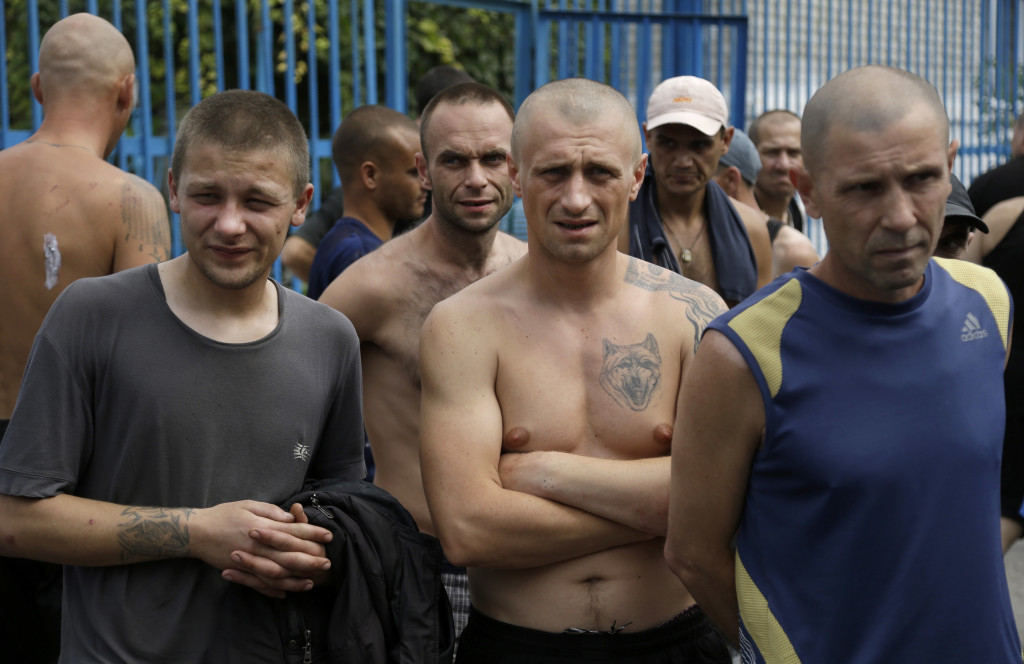Inmates stand in a yard at a high-security facility in Donetsk, eastern Ukraine, on Monday. Authorities say more than 100 prisoners fled from the facility after it was hit by shelling. The Associated Press