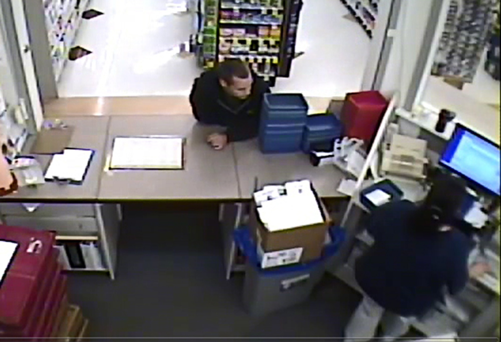 Surveillance footage from the Rite Aid at the corner of Bridge and Spring streets in Gardiner shows a man, leaning on the counter, who is wanted for stealing drugs Thursday.