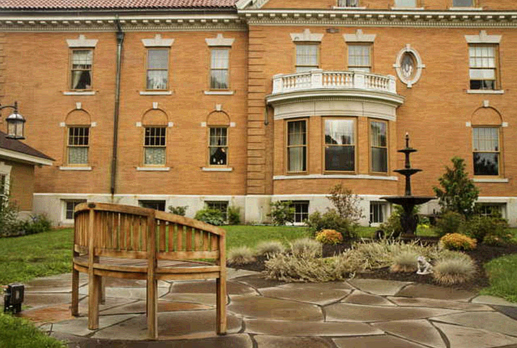 A patio and fountain are a focal point of the grounds of West Mansion. Carl D. Walsh / Staff Photographer