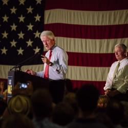 With Democratic U.S. Rep. Mike Michaud behind him, former President Bill Clinton speaks at a rally Tuesday night at the Portland Expo to support Michaud's run for governor.