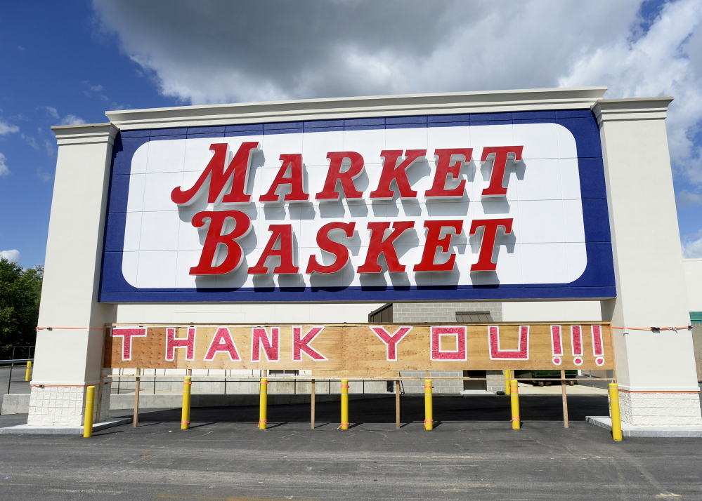 A large sign expressing gratitude is added under the Market Basket sign that can be seen from the Maine Turnpike in Biddeford.