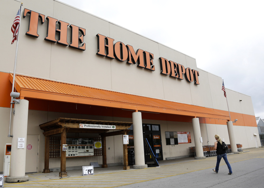 "Home Depot said Tuesday that it's looking into ""unusual activity"" and that it's working with both banks and law enforcement after suspicions of a credit card data breach."