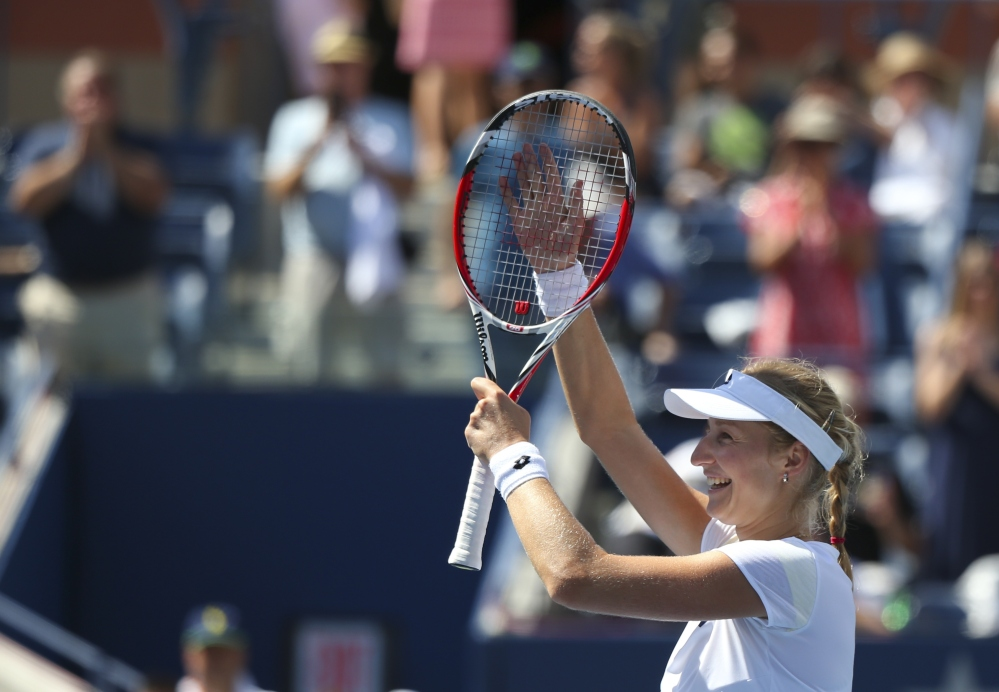 Ekaterina Makarova, of Russia, waves to the crowd after defeating Victoria Azarenka, of Belarus, in two sets during the quarterfinals of the 2014 U.S. Open tennis tournament, Wednesday in New York.