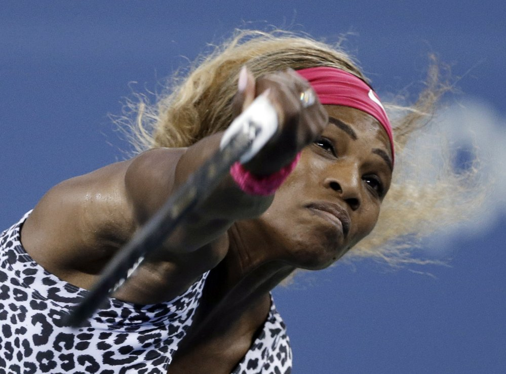 Serena Williams of the United States serves to Flavia Pennetta of Italy during their quarterfinal match at the U.S. Open tennis tournament Wednesdayin New York.