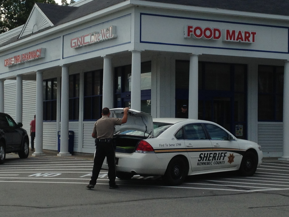 Kennebec County sheriff's deputies respond to a robbery at the Manchester Rite Aid on Saturday. A woman dressed in men's clothes held up the pharmacy for prescription drugs and fled. A police dog was brought in to try to track the robber.