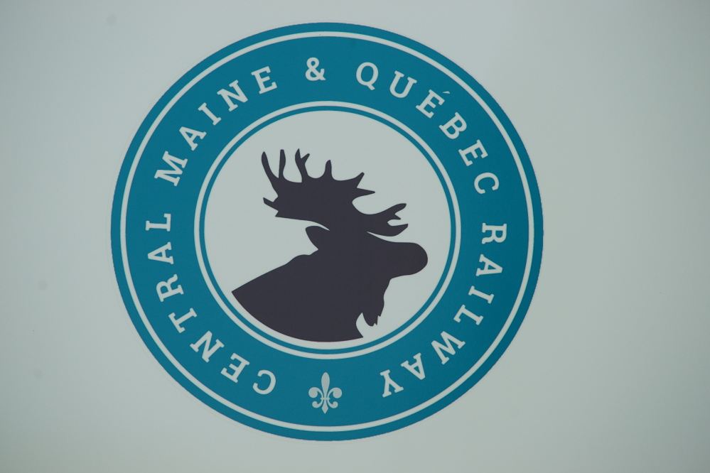 The new logo for the Central Maine & Quebec Railway is on the sign at the railroad's headquarters in Hermon.