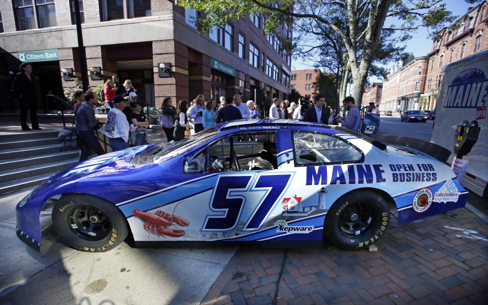 "A race car being billed as the ""Maine Open for Business Chevrolet,"" is introduced tot he public Friday in Portland. The marketing slogan was introduced by Maine Gov. Paul LePage. The high-speed billboard for Maine was partially funded by taxpayers. The Associated Press/Robert F. Bukaty)"
