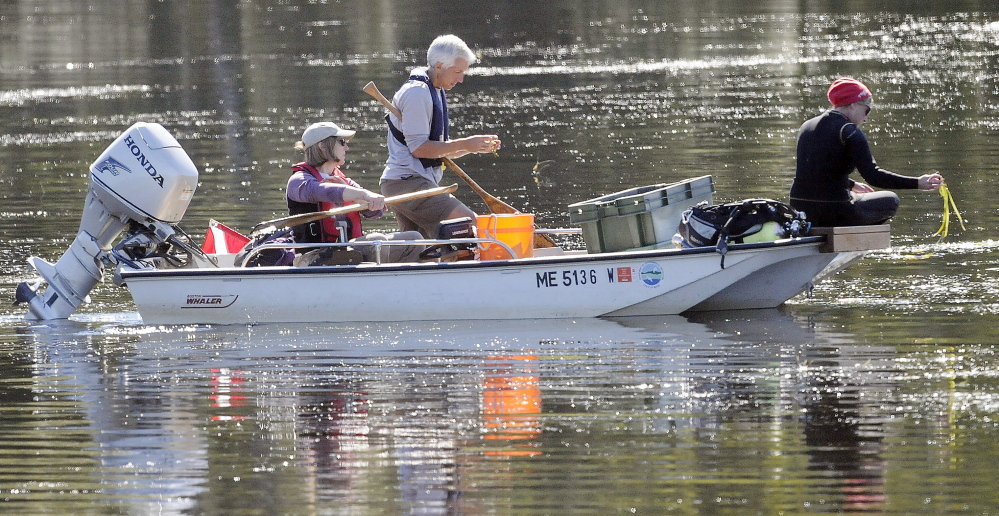 Crews from the Maine Department of Environmental Protection attempt to find invasive variable water milfoil in Annabessacook Lake in Winthrop on Wednesday.
