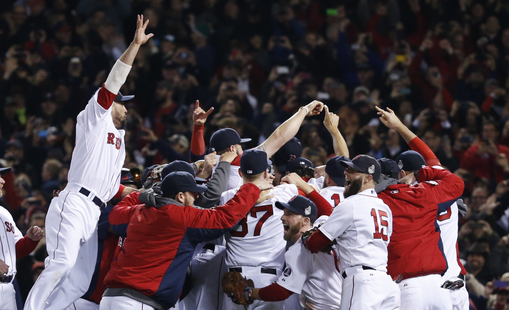Boston Red Sox players celebrate after defeating the St. Louis Cardinals in Game 6 of baseball's World Series Wednesday, Oct. 30, 2013, in Boston. The Red Sox won 6-1 to win the series. The Associated Press