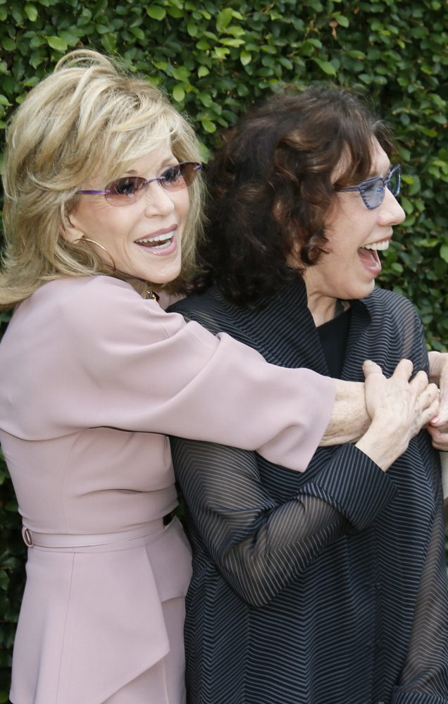 Actress and event host Jane Fonda, left, and actress Lily Tomlin embrace at The Rape Foundation's annual brunch.