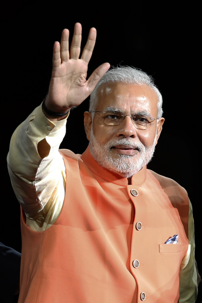 Prime Minister Narendra Modi of India waves as he is introduced before giving a speech at Madison Square Garden in New York on Sunday.