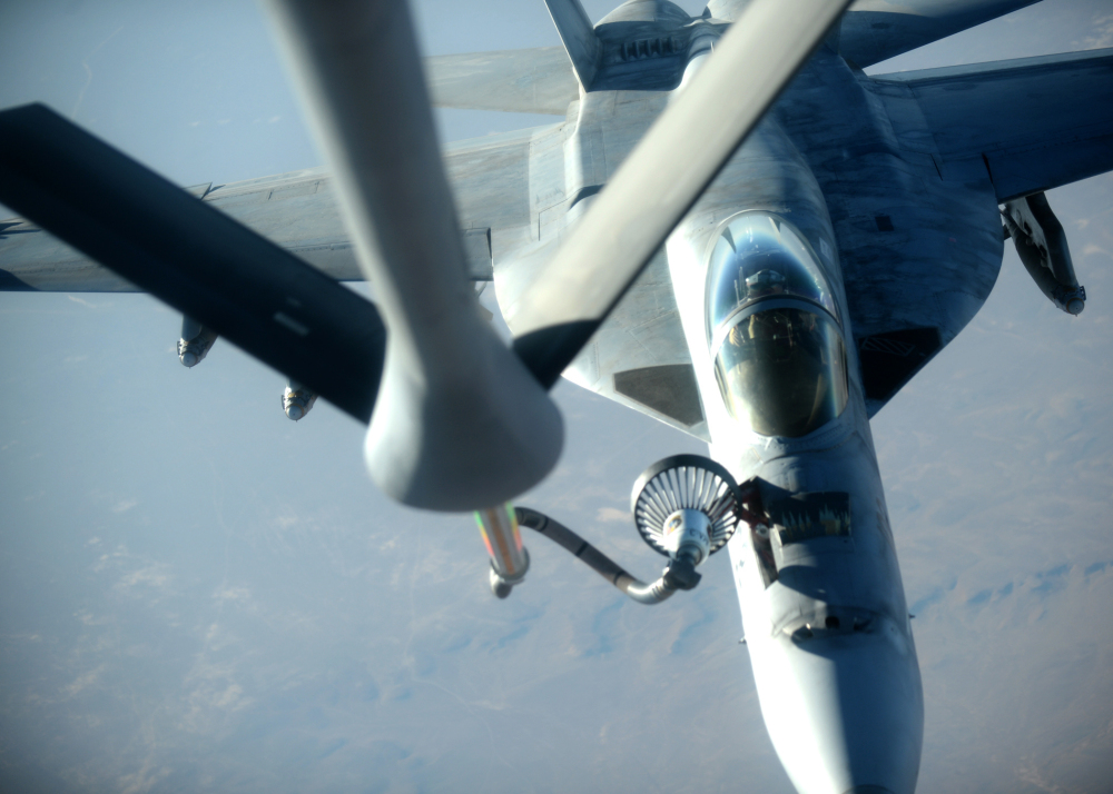 The Associated Press In this Tuesday, Sept. 23, 2014 file photo released by the U.S. Air Force, a U.S. Navy F-18E Super Hornet fighter jet receives fuel from a KC-135 Stratotanker over northern Iraq after conducting airstrikes in Syria as part of U.S.-led coalition airstrikes on the Islamic State group and other targets in Syria.