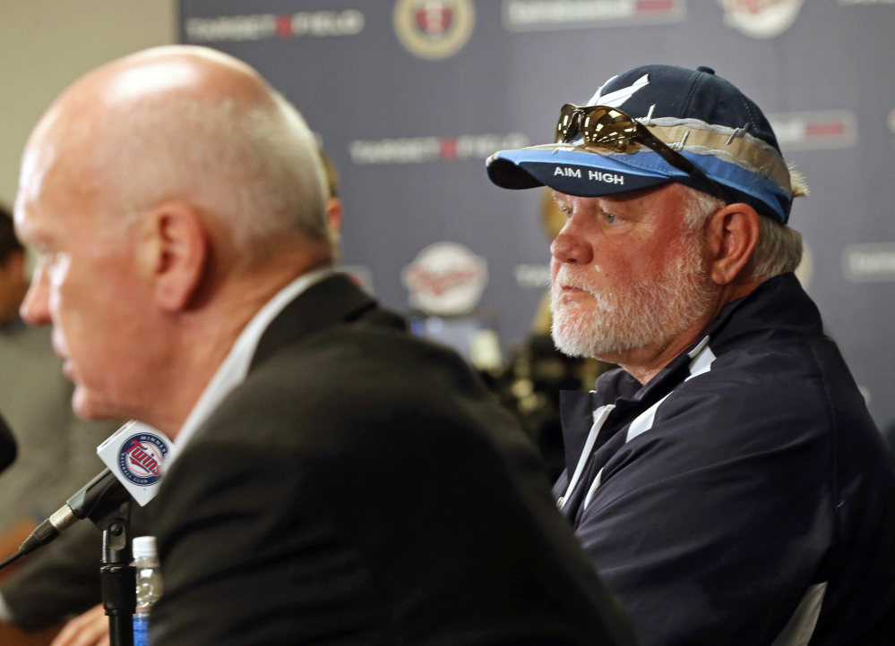 Ron Gardenhire, right, listens as Minnesota Twins general manager Terry Ryan answers a question at a news conference Monday announcing the firing of Gardenhire, who managed the team for 13 seasons.
