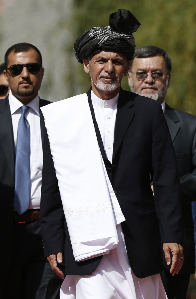 Afghanistan's new President Ashraf Ghani Ahmadzai, center, arrives for his inauguration ceremony at the Presidential Palace in Kabul, Afghanistan, on Monday.
