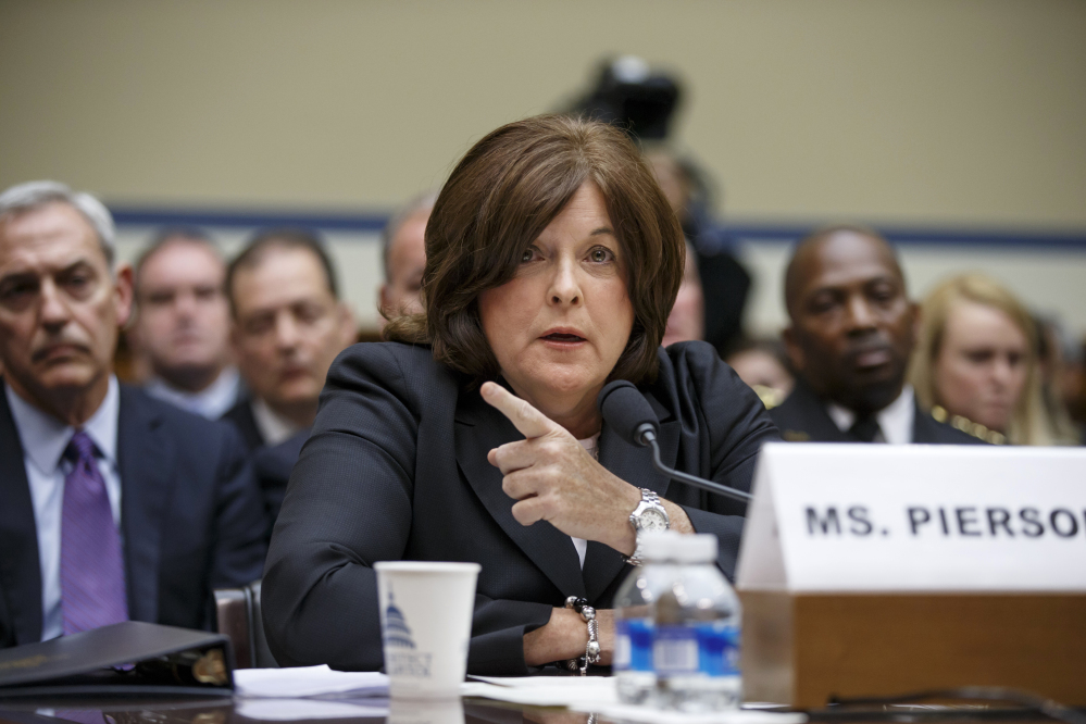 Secret Service Director Julia Pierson testifies on Capitol Hill in Washington, Tuesday, Sept. 30, 2014, before the House Oversight Committee as it examines details surrounding a security breach at the White House when a man climbed over a fence, sprinted across the north lawn and dash deep into the executive mansion before finally being subdued.  (AP Photo/J. Scott Applewhite)