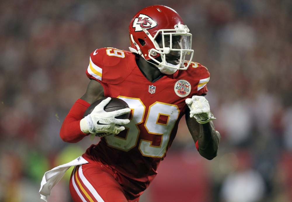 Kansas City Chiefs free safety Husain Abdullah carries the ball after intercepting a pass and running it back 39 yards for a touchdown during the fourth quarter of an NFL football game against the New England Patriots, Monday in Kansas City, Mo.