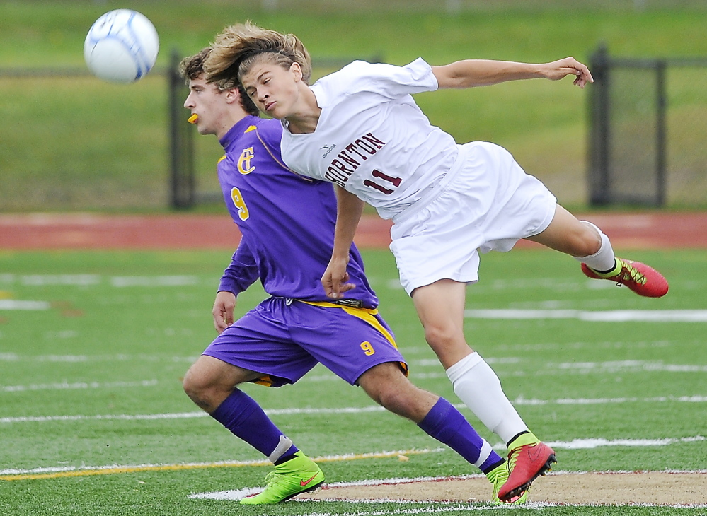 Dalton Moore of Thornton Academy heads the ball away from Mackenzie Hoglund of Cheverus during their SMAA boys' soccer game Tuesday. Thornton improved its record to 6-1-1 with a 2-0 victory.